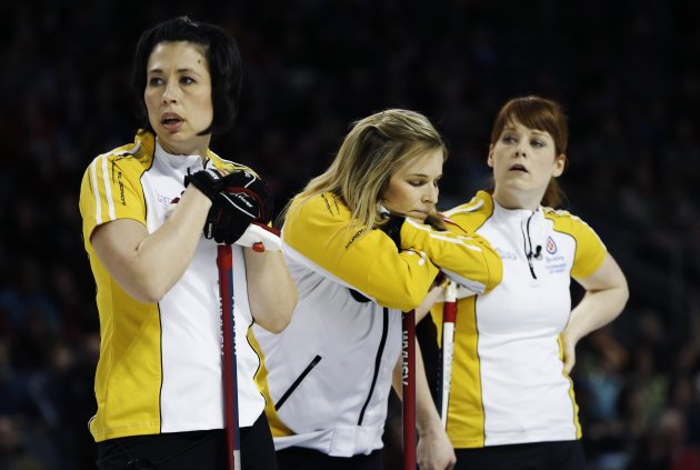 Manitoba skip Jones stands with teammates Officer and Askin during play against Ontario during their gold medal game at the Scotties Tournament of Hearts curling championship in Kingston