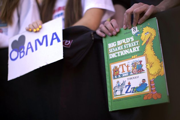 A supporter in the front row holds a Big Bird book as President Barack Obama speaks at a campaign event at The Ohio State University Oval, Tuesday, Oct. 9, 2012, in Columbus, Ohio. (AP Photo/Carolyn Kaster)