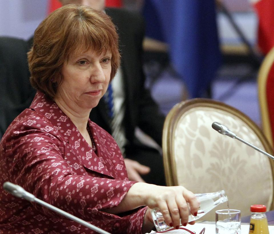 EU foreign policy chief Catherine Ashton, left, pours water in a glass at a start of high-level talks between world powers and Iranian officials in Almaty, Kazakhstan, Friday, April 5, 2013. (AP Photo/Shamil Zhumatov, pool)