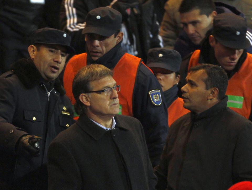 Paraguay's coach Gerardo Martino, front left, watches the game from the stands after being sent off by referee Francisco Chacon during a Copa America semifinal soccer match against Venezuela in Mendoza, Argentina, Wednesday, July 20, 2011. (AP Photo/Roberto Candia)