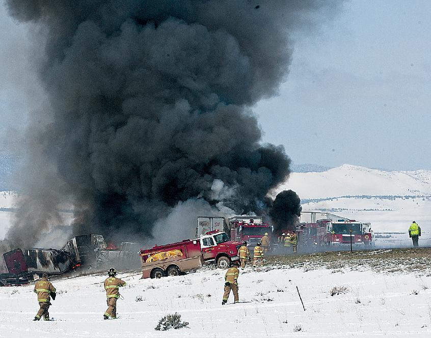Charge reduced against trucker in fatal pileup in Wyoming