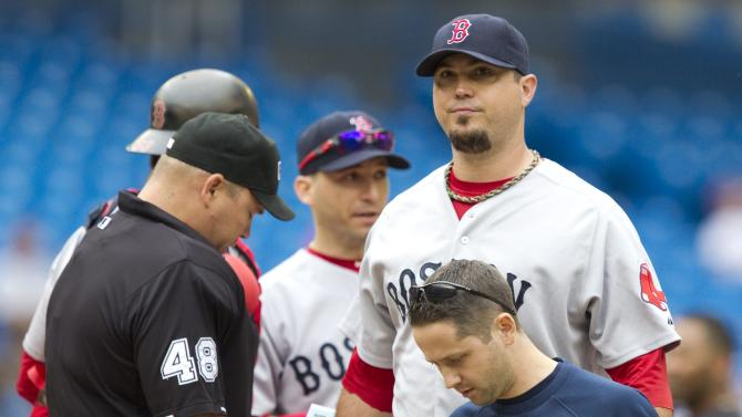 Boston Red Sox starting pitcher Josh Beckett, right, leaves the game with an undisclosed injury during fourth inning of a baseball game against the Toronto Blue Jays in Toronto Monday, Sept. 5, 2011. (AP Photo/The Canadian Press, Darren Calabrese)