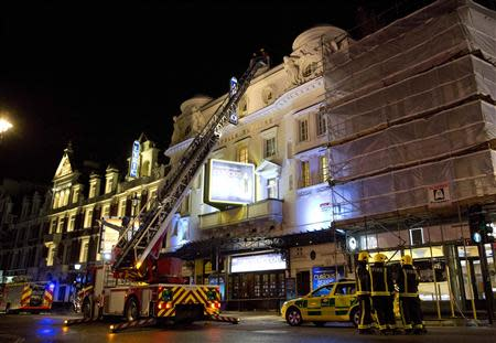 Emergency services look at the roof of the Apollo Theatre on Shaftesbury Avenue after part of the ceiling collapsed in central London