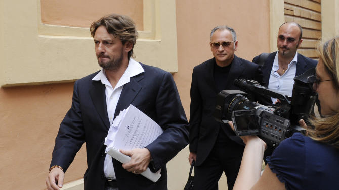 "Giuseppe Signori, left, arrives at the Cremona court, Italy, Wednesday, June 8, 2011. Former Lazio captain Giuseppe Signori was among 16 people arrested last week for alleged involvement in a match-fixing and betting ring throughout Italy. The prosecutor leading the latest inquiry into match-fixing in Italy believes there are ""big problems"" for Serie A. Cremona prosecutor Roberto Di Martino has been coordinating questioning for several of the 16 people arrested across Italy last week. Di Martino said last week that the inquiry is focused on 18 matches mostly in Serie B and C, but key suspects in the case have reportedly divulged information about top division games that were fixed. (AP Photo/Antonio Calanni)"