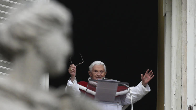 Pope Benedict XVI waves to the faithful during the Angelus noon prayer he celebrated from the window of his studio overlooking St. Peter's square at the Vatican, Sunday, Jan. 13, 2013. (AP Photo/Alessandra Tarantino)