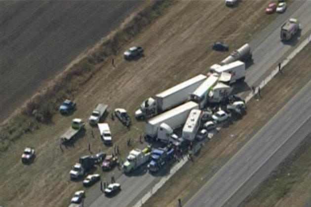 In this image provided by Click2houston.com cars and trucks are piled on Interstate 10 in Southeast Texas Thursday Nov. 22, 2012.  The Texas Department of Public Safety says at least 35 people have be