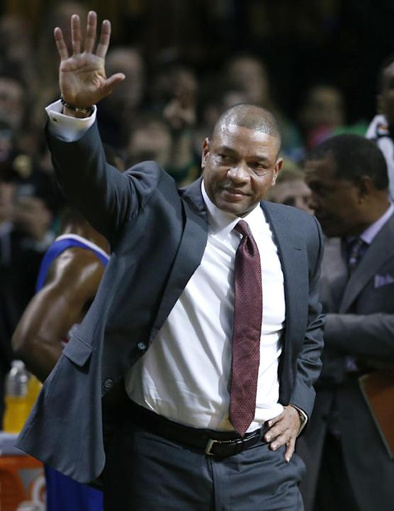 Current Los Angeles Clippers head coach and former Boston Celtics head coach Doc Rivers waves during a video tribute to him for his first time back to the TD Garden, after the first quarter of an NBA