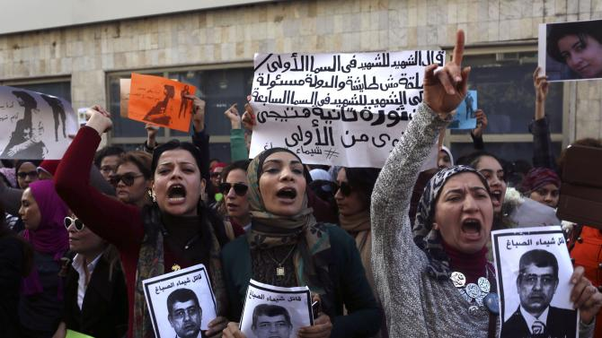 Protesters chant anti-government slogans while holding posters of Egyptian Interior Minister Ibrahim during a protest at same location in central Cairo where activist Sabbagh was killed on Saturday
