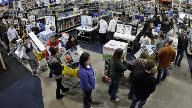 FILE-In this Friday, Nov. 25, 2011, file photo, a checkout line winds through a Best Buy store as shoppers take advantage of a midnight Black Friday sale on Friday, Nov. 25, 2011, in Brentwood, Tenn. The National Retail Federation, the nation's largest retail trade group, said Tuesday, Oct. 2, 2012, that it expects sales during the winter holiday shopping period in November and December to rise 4.1 percent this year. (AP Photo/Mark Humphrey, File)