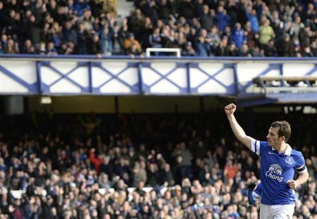Everton's Leighton Baines celebrates after scoring a penalty against Swansea during their English FA Cup fifth round soccer match at Goodison Park in Liverpool, northern England February 16, 2014.