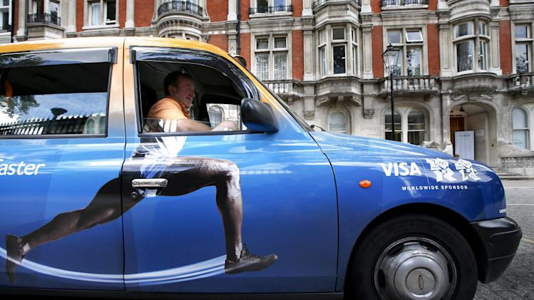 Taxi driver Richard Meid waits for a fare in front of the British Museum during the 2012 Summer Olympics,Wednesday, Aug. 8, 2012, in London. (AP Photo/Jae C. Hong)