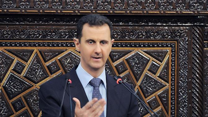 FILE - This June 3, 2012 file photo released by the Syrian official news agency SANA, Syrian President Bashar Assad delivers a speech at the parliament in Damascus, Syria. Arab countries on Wednesday, Aug. 1, 2012 pushed ahead with a symbolic U.N. General Assembly resolution that tells Assad to resign and turn over power to a transitional government. It also demands that the Syrian army stop its shelling and helicopter attacks and withdraw to its barracks. A vote is set for Friday morning. (AP Photo/SANA, File)