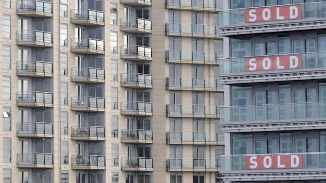 Signs are seen hanging on a new residential property development in west London