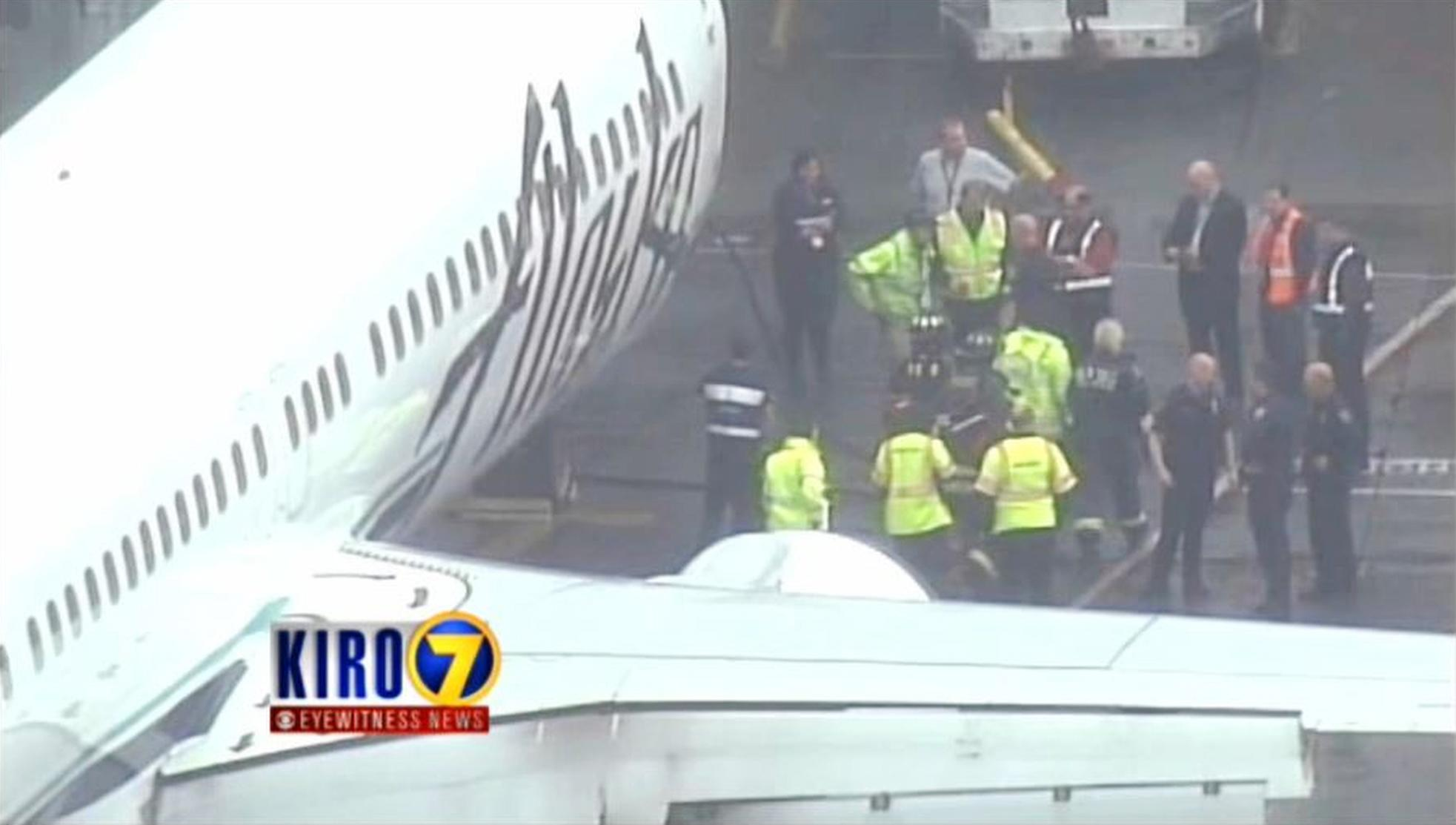 Dispatcher puzzled by 911 call from trapped baggage worker