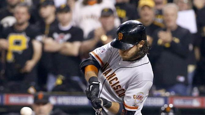 San Francisco Giants' Brandon Crawford hits a grand slam off Pittsburgh Pirates starting pitcher Edinson Volquez during the fourth inning of the NL wild-card playoff baseball game Wednesday, Oct. 1, 2014, in Pittsburgh. (AP Photo/Gene J. Puskar)
