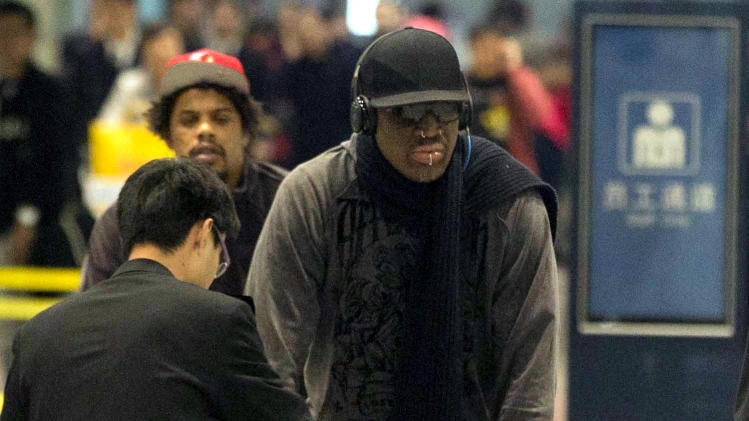 Former NBA star Dennis Rodman, center pushes his cart as he returns from a trip to North Korea at the airport in Beijing, Friday, March 1, 2013. Rodman hung out with North Korea's Kim Jong Un during his improbable journey to Pyongyang, watching the Harlem Globetrotters with the leader and later drinking and dining on sushi with him(AP Photo/Ng Han Guan)