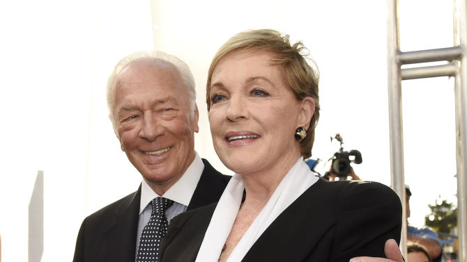"""Christopher Plummer, left, and Julie Andrews, cast members in the classic film """"The Sound of Music,"""" pose together before a 50th anniversary screening of the film at the opening night gala of the 2015 TCM Classic Film Festival on Thursday, March 26, 2015, in Los Angeles. (Photo by Chris Pizzello/Invision/AP)"""
