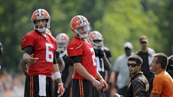 Cleveland Browns quarterback Brian Hoyer (6) and Johnny Manziel at the NFL football team's training camp in Berea, Ohio Saturday, July 26, 2014. (AP Photo/Mark Duncan)