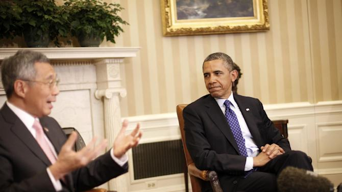 President Barack Obama listens to Singapore Prime Minister Lee Hsien Loong during their meeting in the Oval Office of the White House in Washington, Tuesday, April, 2, 2013.  (AP Photo/Pablo Martinez Monsivais)