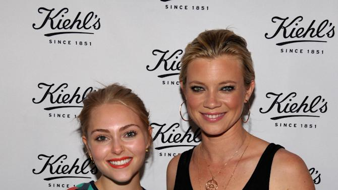 Actresses AnnaSophia Robb, left, and Amy Smart attend Kiehl's Earth Day Celebration with Zachary Quinto and Alanis Morissette at Kiehl's on Wednesday, April  17, 2013, in Santa Monica, Calif. (Photo by John Shearer/Invision for Kiehl's/AP Images)
