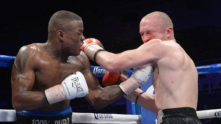 Lukas Konecny (R) of the Czech Republic exchanges blows with Peter Quillin of the US during their WBO Middleweight title fight on April 19, 2014 at the DC Armory in Washington, DC which Quillin won by unanimous decison