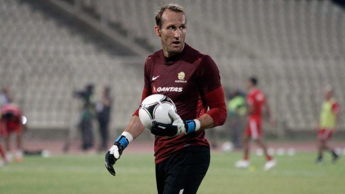 Mark Schwarzer says the Socceroos have to 'wake up to themselves' ahead of the crucial tie against Iraq