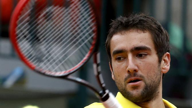 Marin Cilic of Croatia plays a shot to Robin Haase of the Netherlands during their men's singles match at the French Open tennis tournament at the Roland Garros stadium in Paris