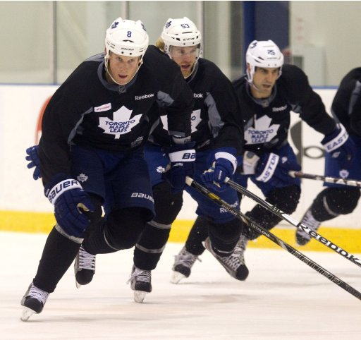 Toronto Maple Leafs players Mike Komisarek Mike Kostka and Mike Mottau skate sprints on the first day of training camp in Toronto.