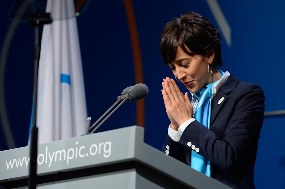 Tokyo 2020 Bid Ambassador Christel Takigawa greets the audience before speaking during theTokyo 2020 bid presentation in Buenos Aires, Argentina, Saturday, Sept. 7, 2013. Madrid, Istanbul and Tokyo are competing to host the 2020 Summer Olympic Games. (AP Photo/Fabrice Coffrini, Pool)