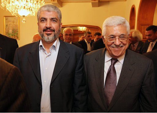 FILE - In this Thursday, Nov. 24, 2011 file handout photo provided by the office of Khaled Meshaal, Palestinian President Mahmoud Abbas, right, and Khaled Mashaal, left, chief of the Islamic militant Hamas, appear together for a meeting in Cairo, Egypt. Hamas has secretly chosen new leaders for Gaza, starting movement-wide elections that could determine if the Islamic militants will moderate or maintain an alliance with longtime patron Iran instead, Hamas officials said Thursday, April 26, 2012. (AP Photo/Office of Khaled Meshaal, HO, File) EDITORIAL USE ONLY