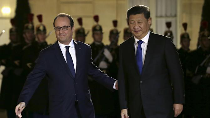 French President Francois Hollande welcomes his Chinese counterpart Xi Jinping for a working dinner at the Elysee palace in Paris