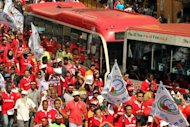 Workers march and chant slogans during a May Day rally in Kuala Lumpur. Several dozen workers and activists gathered in Kuala Lumpur as Malaysian Prime Minister Najib Razak announced the country&#39;s first ever minimum wage for private sector employees