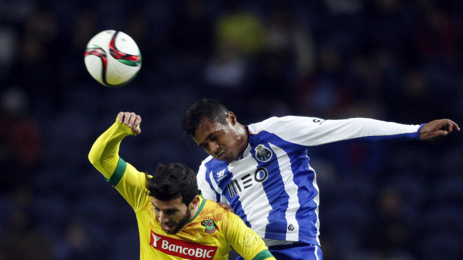 Porto's Alex jumps for the ball with Pazos de Ferreira's Minhoca during their Portuguese Premier League soccer match at Dragao stadium in Porto