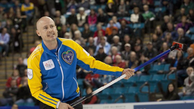 Team Alberta skip Kevin Koe reacts in the 1st end during their draw against team British Columbia at the 2014 Tim Hortons Brier curling championships in Kamloops