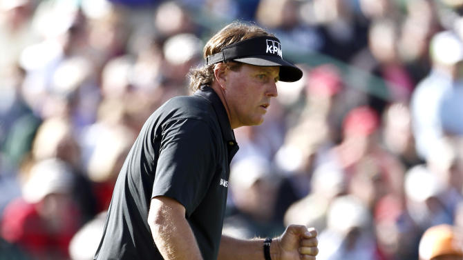 Phil Mickelson pumps his fist after making birdie on the 16th hole during the first round of the Waste Management Phoenix Open golf tournament Thursday, Jan. 31, 2013, in Scottsdale, Ariz. (AP Photo/Ross D. Franklin)