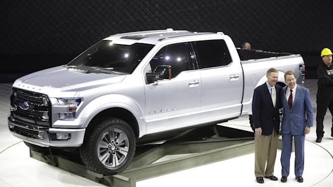 Ford Motor Co. Executive Chairman Bill Ford, right, and President and CEO Alan Mulally stand next to the Ford Atlas concept pickup after its unveil at the North American International Auto Show in Detroit, Tuesday, Jan. 15, 2013. (AP Photo/Carlos Osorio)
