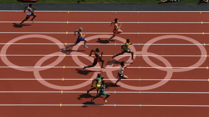 Jamaica's Yohan Blake takes the lead in his men's 100m round 1 heats at the London 2012 Olympic Games at the Olympic Stadium
