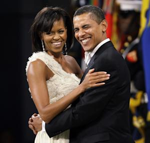 FILE - This Jan. 20, 2009 file photo shows President Barack Obama and first lady Michelle Obama dance together at the Obama Home States Inaugural Ball in Washington. A new exhibit opens Nov. 19, 2011, at the Smithsonian's National Museum of American History will feature the gown the first lady wore to the inaugural balls. (AP Photo/Charlie Neibergall, File)
