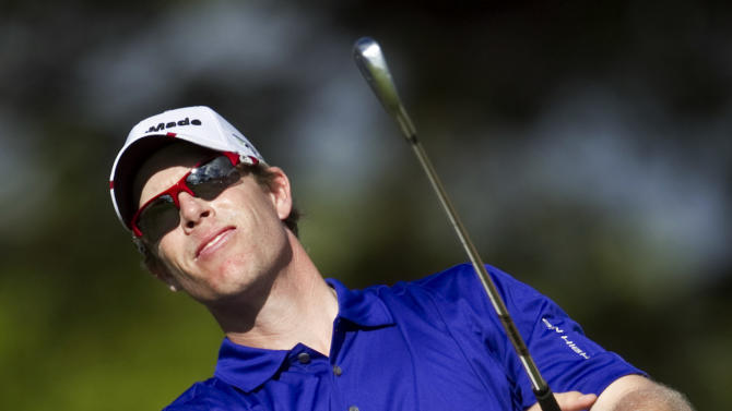 David Hearn follows his shot off the 11th green during the second round of the Sony Open golf tournament, Friday, Jan. 13, 2012, in Honolulu. (AP Photo/Marco Garcia)