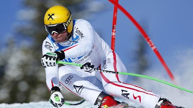 Austrian skier Max Franz hits a gate as he posts the fastest time during alpine skiing training for the Men's World Cup downhill in Lake Louise