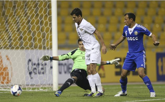Qatar ElJaish's Ko scores a goal next to teammate Da Silva and goalkeeper Suyunov of Uzbekistan's Nasaf during their AFC Championship League match in Doha