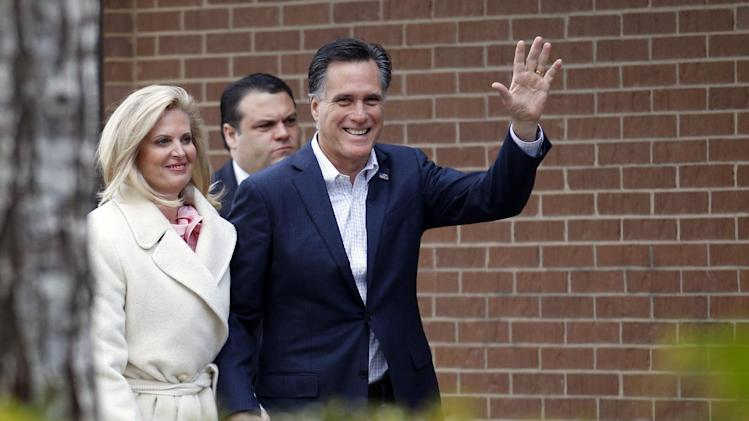 Republican presidential candidate, former Massachusetts Gov. Mitt Romney and his wife Ann arrive to host a pancake breakfast at Brookwood High School in Brookwood, Ga.,  Sunday, March 4, 2012. (AP Photo/Gerald Herbert)