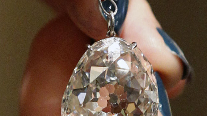 The Beau Sancy, a 34.98 carat diamond that will be put on sale by Sotheby's auction house in Geneva next month, is presented in Paris, Monday April 23, 2012. The Beau Sancy diamond, a stone of historical importance with a royal provenance stretching back to Marie de Medicis is estimated between two and four million dollars, (1.5 to 3 million Euros).(AP Photo/Remy de la Mauviniere)