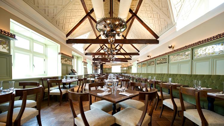 This April 13, 2014 photo provided by Tavern on the Green, shows a newly renovated dining room at Tavern on the Green in New York. The once-grand restaurant in Central Park, which has been closed since the previous operators lost their lease and declared bankruptcy in 2009, reopens Thursday, April 24, 2014 under new management. (AP Photo/Tavern on the Green, Robin Caiola)