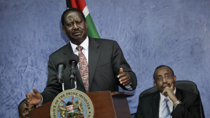 Kenyan Prime Minister Raila Odinga, center-left, accompanied by Somali Prime Minister Abdiweli Mohamed Ali, right, speaks to the media following their meeting in Nairobi, Kenya Monday, Oct. 31, 2011. An air strike hit a refugee camp in southern Somalia killing at least three people and wounding dozens of women and children, an international aid agency said Monday, while Kenya's military acknowledged carrying out an air raid but said it killed only Islamist militants, and Somali Prime Minister Abdiweli Mohamed Ali said his government is looking into the airstrike and reported civilian deaths. (AP Photo/Ben Curtis)
