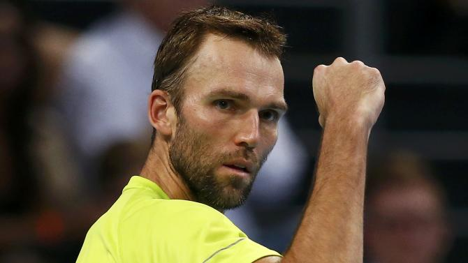 Karlovic of Croatia reacts during his semi-final match against Switzerland's Federer at the Swiss Indoors ATP tennis tournament in Basel