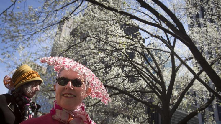 Women attend the annual Easter Bonnet Parade in New York