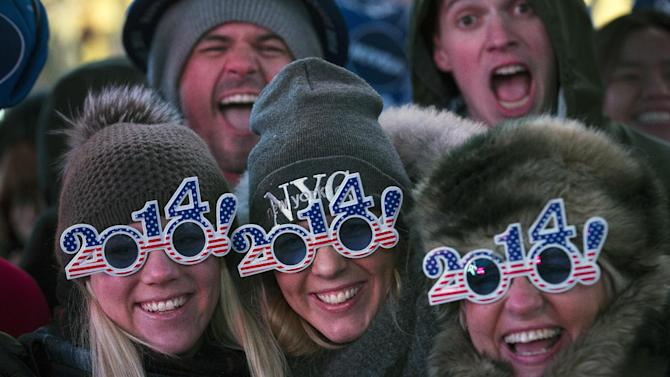Revelers pose for a photograph as they wait for midnight during the New Year's Eve celebrations in Times Square, Tuesday, Dec. 31, 2013, in New York. (AP Photo/John Minchillo)