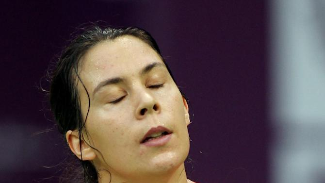 France's Marion Bartoli  reacts after losing a point against Francesca Schiavone of Italy during the Second day of the WTA Qatar Ladies Open in Doha, Qatar, Tuesday, Feb. 12, 2013. (AP Photo/Osama Faisal)