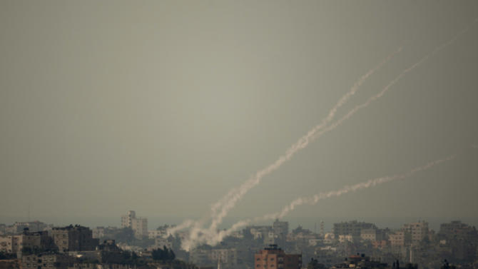 Smoke trails of rocket fired by Palestinian militants from Gaza Strip towards Israel, Wednesday, Oct. 24, 2012. Gaza militants pummeled southern Israel with dozens of rockets and mortars on Wednesday, and Israeli airstrikes killed two Palestinians in a sharp escalation of violence following a landmark visit to the coastal territory by the leader of Qatar. (AP Photo/Ariel Schalit)